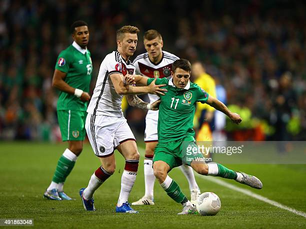 Marco Reus of Germanytackles Wes Hoolahan of Republic of Ireland during the UEFA EURO 2016 Qualifier group D match between Republic of Ireland and...