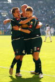 Marco Reus of Moenchengladbach celebrates scoring the first goal with team mates Thorben MArx and Michael Bradley during the Bundesliga match between...