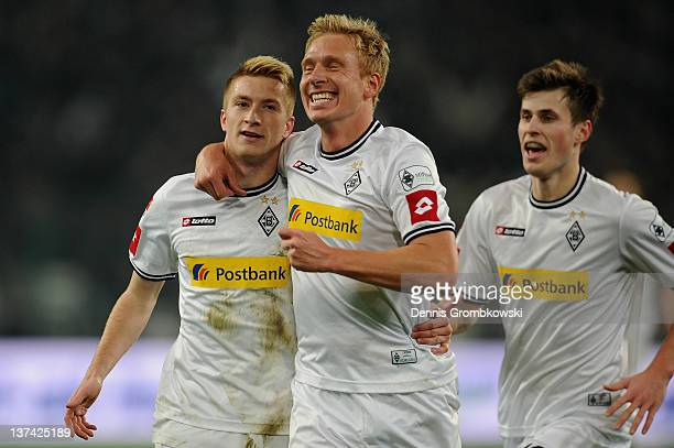 Marco Reus of Moenchengladbach celebrates with teammate Mike Hanke after scoring his team's opening goal during the Bundesliga match between Borussia...