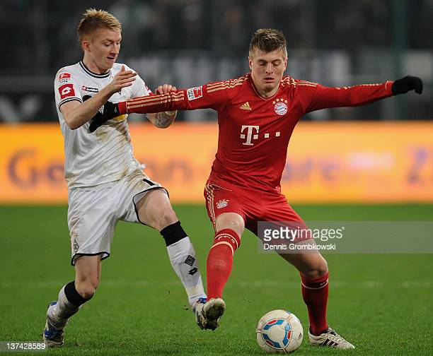 Marco Reus of Moenchengladbach challenges Toni Kroos of Bayern during the Bundesliga match between Borussia Moenchengladbach and FC Bayern Muenchen...