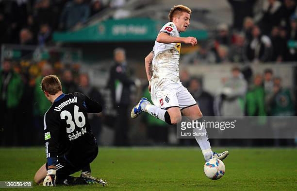 Marco Reus of Moenchengladbach is on his way to score his teams third goal during the DFB Cup round of sixteen match between Borussia...