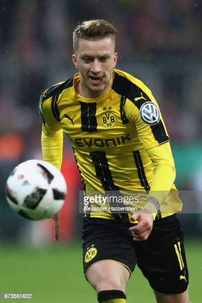 Marco Reus of Muenchen runs with the ball during the DFB Cup semi final match between FC Bayern Muenchen and Borussia Dortmund at Allianz Arena on...