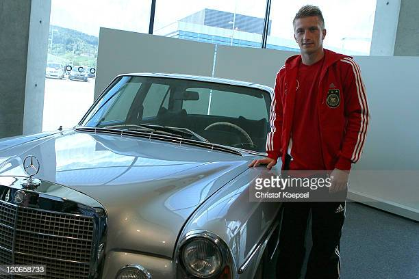 Marco Reus poses in front of a MercedesBenz car during a press conference of the German National football team at MercedesBenz Museum on August 8...