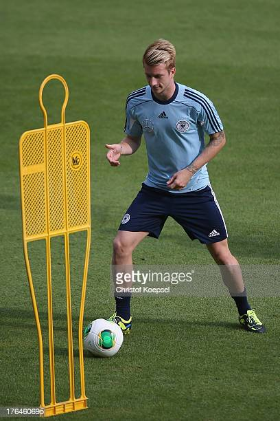 Marco Reus runs with the ball during the training of Germany at Coface Arena on August 13 2013 in Mainz Germany The team of Germany will play a...