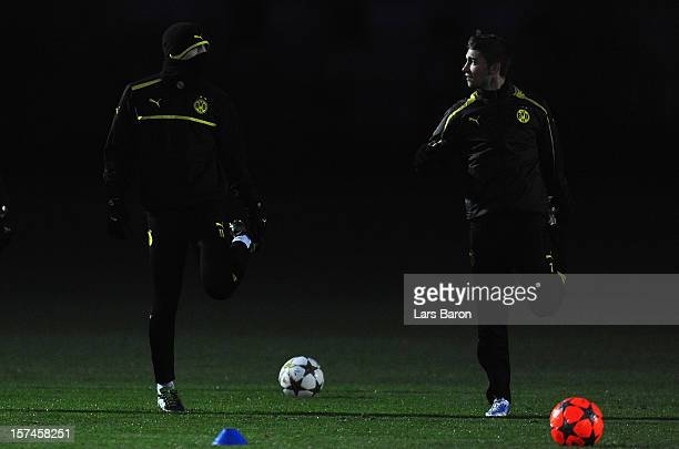 Marco Reus warms up with Moritz Leitner during a Borussia Dortmund training session ahead of their UEFA Champions League group stage match against...