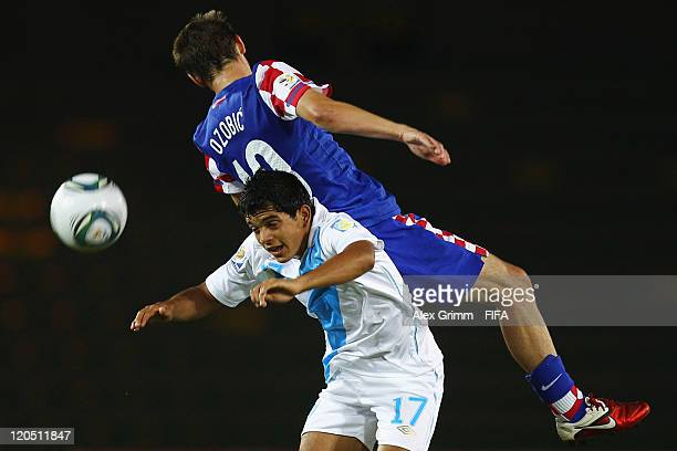 Marco Rivas of Guatemala is challenged by Filip Ozobic of Croatia during the FIFA U20 World Cup 2011 Group D match between Croatia and Guatemala at...