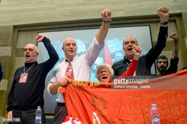 Marco Rizzo general secretary of the Communist Party makes a raised fist salute with comrades during the event International 'Long Live The Soviet...