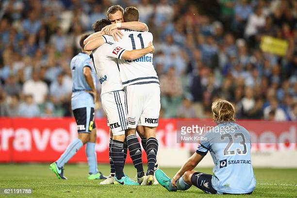 Marco Rojas and Besart Berisha of the Victory clelebrate with Mitch Austin of the Victory after he scored a goal during the round five ALeague match...