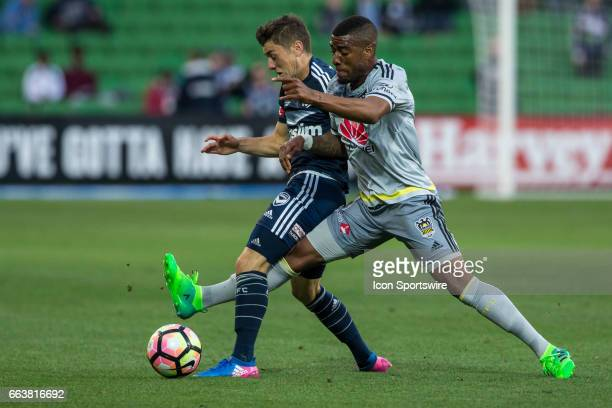 Marco Rojas of Melbourne Victory and Roly Bonevacia of the Wellington Phoenix contest the ball during the round 25 match of the Hyundai ALeague...
