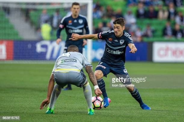 Marco Rojas of Melbourne Victory controls the ball in front of Roly Bonevacia of the Wellington Phoenix during the round 25 match of the Hyundai...