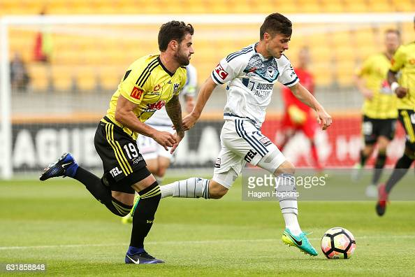 Marco Rojas of Melbourne Victory is challenged by Tom Doyle of the Phoenix during the round seven ALeague match between the Wellington Phoenix and...