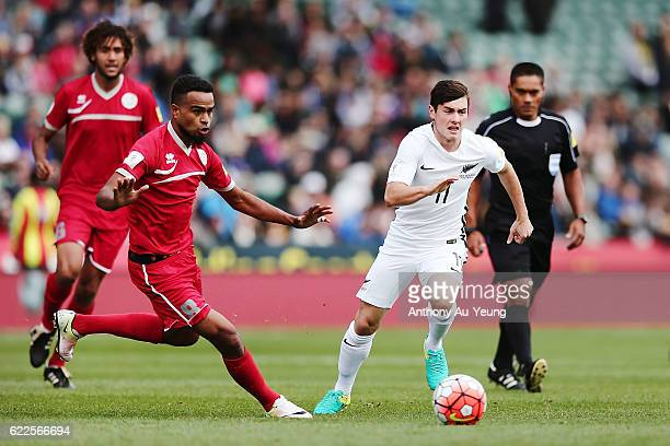 Marco Rojas of New Zealand competes against Emile Bearune of New Caledonia during the 2018 FIFA World Cup Qualifier match between the New Zealand All...