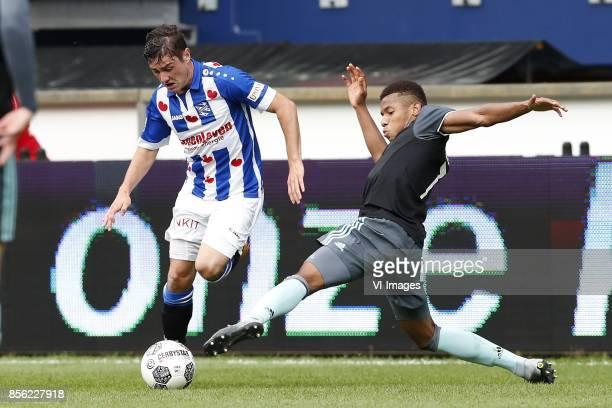 Marco Rojas of sc Heerenveen David Neres of Ajax during the Dutch Eredivisie match between sc Heerenveen and Ajax Amsterdam at Abe Lenstra Stadium on...