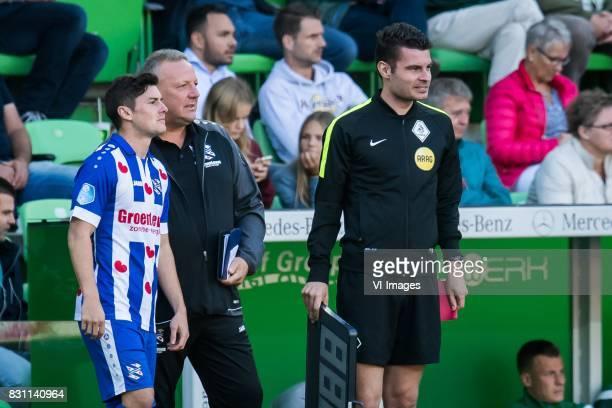 Marco Rojas of sc Heerenveen team manager Herman van Dijk Erwin Blank during the Dutch Eredivisie match between FC Groningen and sc Heerenveen at...