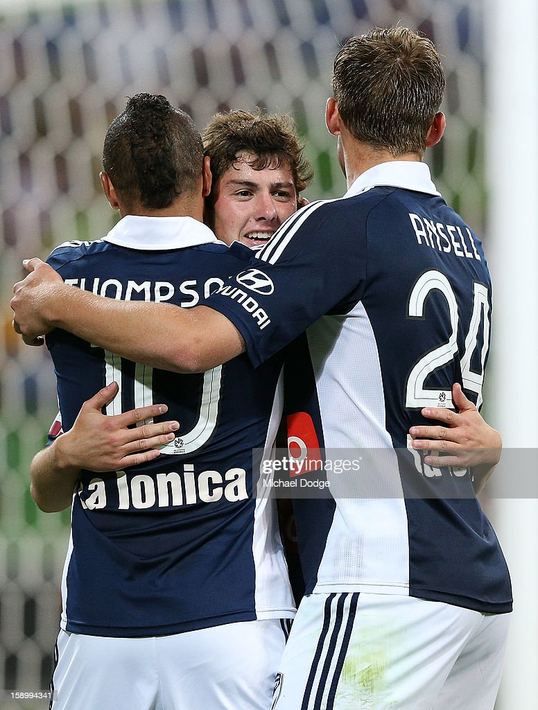 Marco Rojas (C) of the Melbourne Victory celebrates his goal with Archie Thompson (L) and Nick Ansell during the round 15 A-League match between the Melbourne Victory and Wellington Phoenix at AAMI Park on January 5, 2013 in Melbourne, Australia.