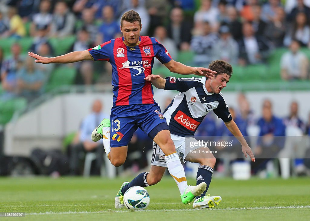 Marco Rojas of the Victory and Samuel Gallaway of the Jets compete for the ball during the round 13 A-League match between the Melbourne Victory and the Newcastle Jets at AAMI Park on December 28, 2012 in Melbourne, Australia.