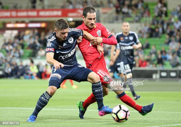 Marco Rojas of the Victory and Sergio Cirio of United compete for the ball during the round 21 ALeague match between Melbourne Victory and Adelaide...