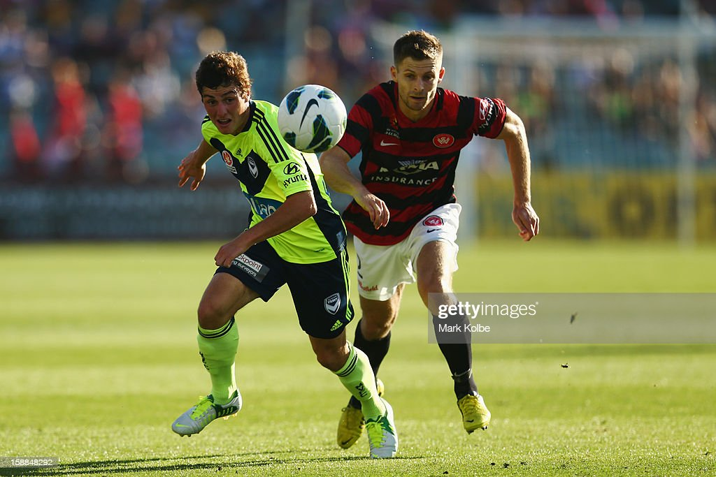 Marco Rojas of the Victory and Shannon Cole of the Wanderers compete for the ball during the round 14 A-League match between the Western Sydney Wanderers and the Melbourne Victory at Parramatta Stadium on January 1, 2013 in Sydney, Australia.