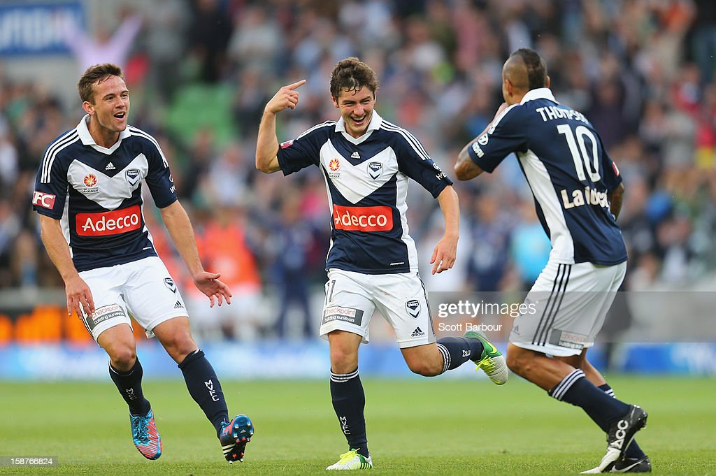 Marco Rojas (C) of the Victory celebrates after he scored the first goal with Archie Thompson during the round 13 A-League match between the Melbourne Victory and the Newcastle Jets at AAMI Park on December 28, 2012 in Melbourne, Australia.
