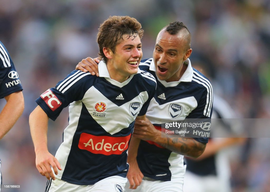 Marco Rojas (L) of the Victory celebrates after he scored the first goal with Archie Thompson during the round 13 A-League match between the Melbourne Victory and the Newcastle Jets at AAMI Park on December 28, 2012 in Melbourne, Australia.