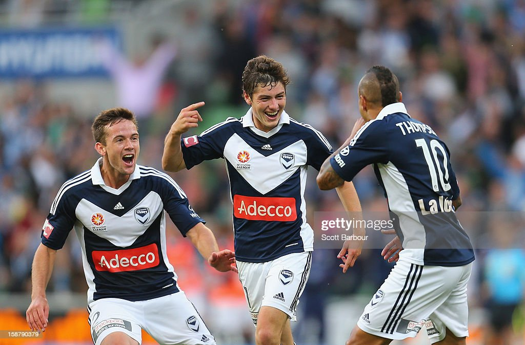 Marco Rojas (C) of the Victory celebrates after he scored the first goal with Archie Thompson (R) and Matthew Foschini during the round 13 A-League match between the Melbourne Victory and the Newcastle Jets at AAMI Park on December 28, 2012 in Melbourne, Australia.
