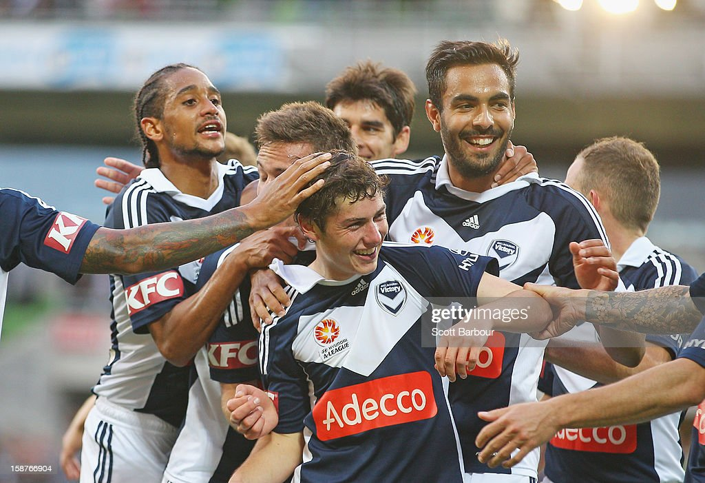Marco Rojas (C) of the Victory celebrates with his team mates after he scored the first goal during the round 13 A-League match between the Melbourne Victory and the Newcastle Jets at AAMI Park on December 28, 2012 in Melbourne, Australia.