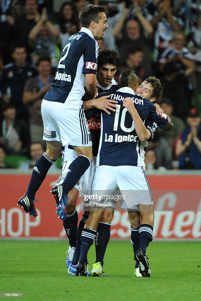 Marco Rojas of the Victory celebrates with team-mates after scoring goal in the second half during the round 13 A-League match between the Melbourne Victory and the Newcastle Jets at AAMI Park on December 28, 2012 in Melbourne, Australia.