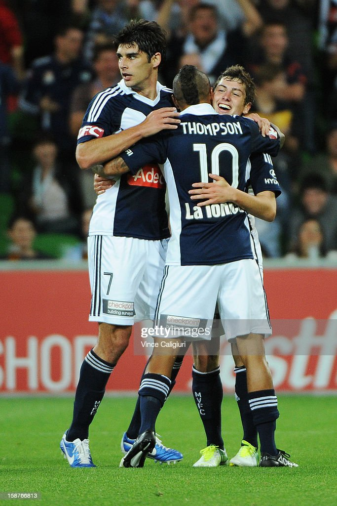 Marco Rojas of the Victory celebrates with teammates Archie Thompson and Guilherme Finkler after scoring goal in the second half during the round 13 A-League match between the Melbourne Victory and the Newcastle Jets at AAMI Park on December 28, 2012 in Melbourne, Australia.