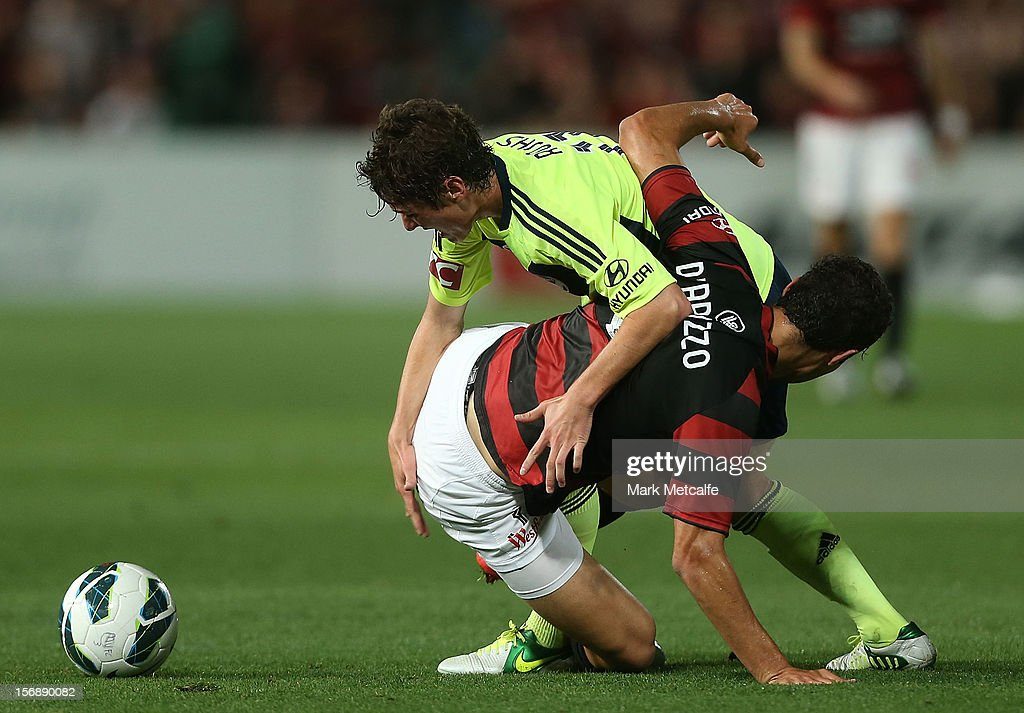 Marco Rojas of the Victory is challenged by Adam D'Appuzo of the Wanderers during the round eight A-League match between the Western Sydney Wanderers and the Melbourne Victory at Parramatta Stadium on November 24, 2012 in Sydney, Australia.
