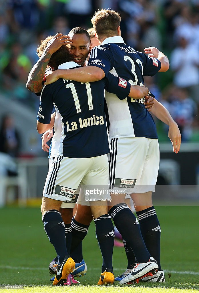 Marco Rojas of the Victory is congratulated by team mates after scoring a goal during the round 23 A-League match between the Melbourne Victory and the Newcastle Jets at AAMI Park on March 3, 2013 in Melbourne, Australia.