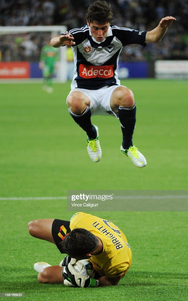 <a gi-track='captionPersonalityLinkClicked' href=/galleries/search?phrase=Marco+Rojas&family=editorial&specificpeople=6084696 ng-click='$event.stopPropagation()'>Marco Rojas</a> of the Victory jumps over keeper Mark Birighitti of the Jets during the round 13 A-League match between the Melbourne Victory and the Newcastle Jets at AAMI Park on December 28, 2012 in Melbourne, Australia.