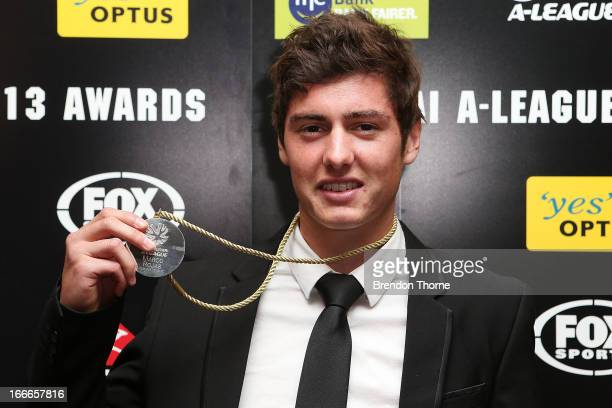 SYDNEY AUSTRALIA APRIL Marco Rojas of the Victory poses with the Johnny Warren Medal as the Hyundai ALeague Player of the Year Award during the 2013...