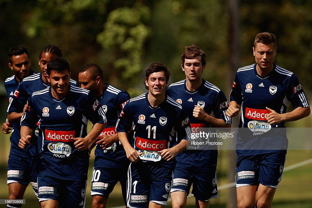 <a gi-track='captionPersonalityLinkClicked' href=/galleries/search?phrase=Marco+Rojas&family=editorial&specificpeople=6084696 ng-click='$event.stopPropagation()'>Marco Rojas</a> runs with team-mates during a Melbourne Victory A-League training session at Gosch's Paddock on November 20, 2012 in Melbourne, Australia.