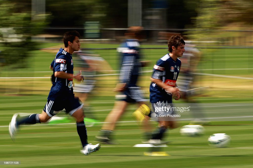 <a gi-track='captionPersonalityLinkClicked' href=/galleries/search?phrase=Marco+Rojas&family=editorial&specificpeople=6084696 ng-click='$event.stopPropagation()'>Marco Rojas</a> runs with the ball during a Melbourne Victory A-League training session at Gosch's Paddock on November 20, 2012 in Melbourne, Australia.