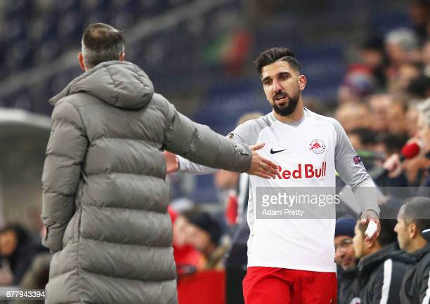 Marco Rose head coach of Red Bull Salzburg congratulates Munas Dabbur of Red Bull Salzburg after he is substituted during the UEFA Europa League...