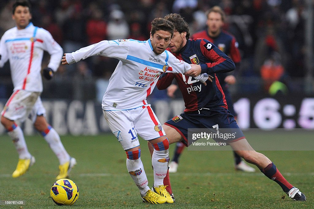 <a gi-track='captionPersonalityLinkClicked' href=/galleries/search?phrase=Marco+Rossi&family=editorial&specificpeople=3649725 ng-click='$event.stopPropagation()'>Marco Rossi</a> (R) of Genoa CFC competes with Alejandro Dario Gomez of Calcio Catania during the Serie A match between Genoa CFC and Calcio Catania at Stadio Luigi Ferraris on January 20, 2013 in Genoa, Italy.