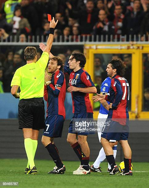 Marco Rossi of Genoa protests as referee Roberto Rosetti shows a red card to Giuseppe Biava of Genoa during the Serie A match between Genoa CFC and...