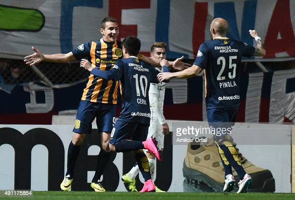 Marco Ruben of Rosario Central celebrates with Franco Cervi and Javier Pinola after scoring the second goal of his team during a match between San...