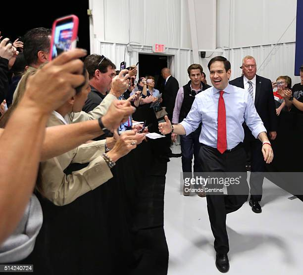 Marco Rubio greets supporters as he arrives for his rally at Sanford International Airport in Sanford Fla on Monday March 7 2016