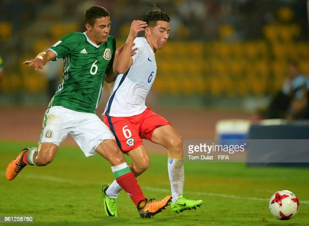 Marco Ruiz of Mexico and Martin Lara of Chile in action during the FIFA U17 World Cup India 2017 group E match between Mexico and Chile at Indira...
