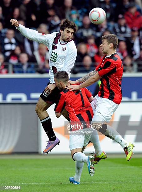Marco Russ and Benjamin Koehler of Frankfurt battles for the ball with Mathias Abel of Kaiserslautern during the Bundesliga match between Eintracht...