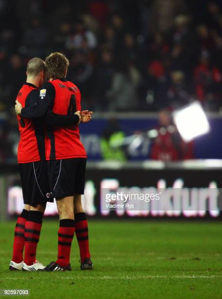 Marco Russ and Maik Franz of Frankfurt celebrate after the final whistle of the Bundesliga match between Eintracht Frankfurt and VfL Bochum at...