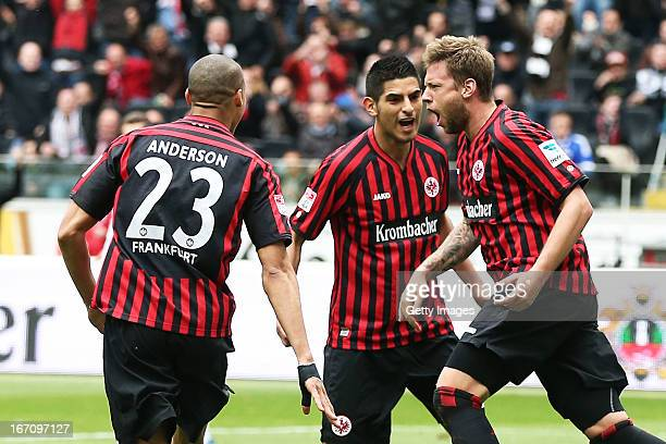 Marco Russ celebrates after scoring his team's first goal with Anderson and Carlos Zambrano of Frankfurt during the Bundesliga match between...