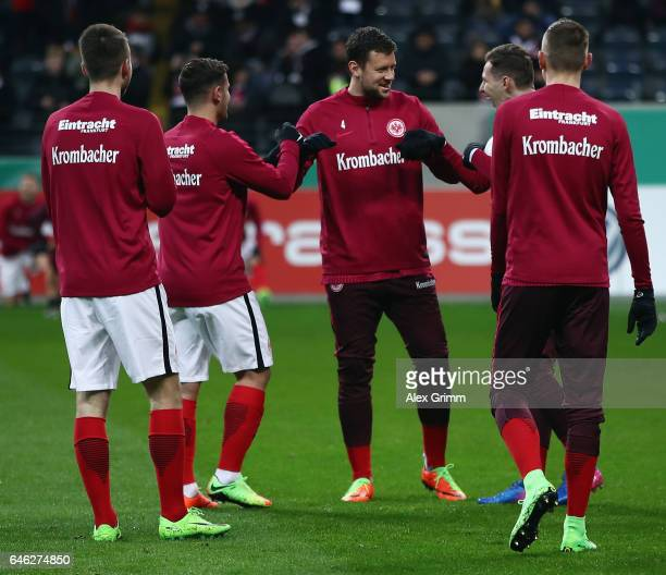 Marco Russ of Frankfurt and team mates warm up prior to the DFB Cup quarter final between Eintracht Frankfurt and Arminia Bielefeld at Commerzbank...