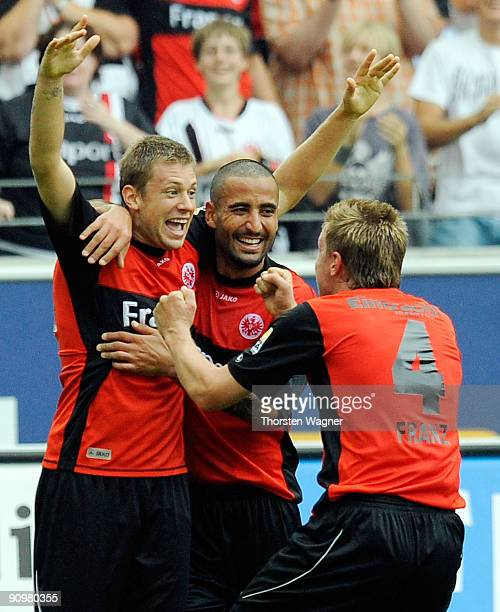 Marco Russ of Frankfurt celebrates after scoring his team's first goal with his team mates Maik Franz and Selim Teber during the Bundesliga match...