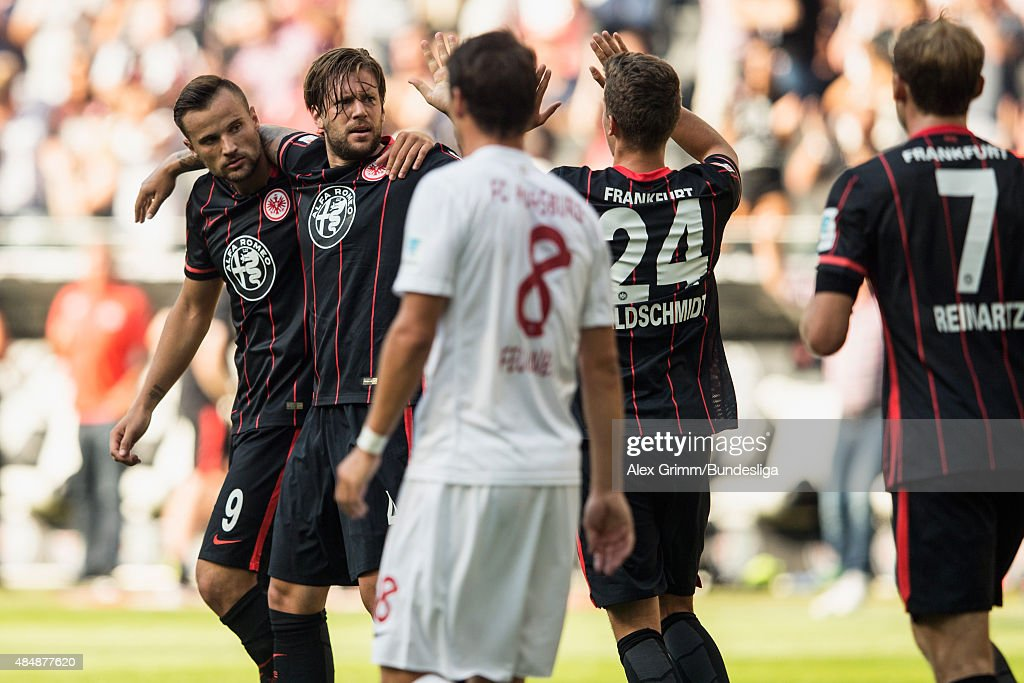 <a gi-track='captionPersonalityLinkClicked' href=/galleries/search?phrase=Marco+Russ&family=editorial&specificpeople=653868 ng-click='$event.stopPropagation()'>Marco Russ</a> (2L) of Frankfurt celebrates his team's first goal with team mates Haris Seferovic, Luca Waldschmidt and <a gi-track='captionPersonalityLinkClicked' href=/galleries/search?phrase=Stefan+Reinartz&family=editorial&specificpeople=2244849 ng-click='$event.stopPropagation()'>Stefan Reinartz</a> (L-R) as <a gi-track='captionPersonalityLinkClicked' href=/galleries/search?phrase=Markus+Feulner&family=editorial&specificpeople=623655 ng-click='$event.stopPropagation()'>Markus Feulner</a> of Augsburg reacts during the Bundesliga match between Eintracht Frankfurt and FC Augsburg at Commerzbank-Arena on August 22, 2015 in Frankfurt am Main, Germany.