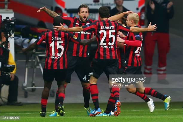 Marco Russ of Frankfurt celebrates his team's second goal with team mates during the UEFA Europa League Group F match between Eintracht Frankfurt and...