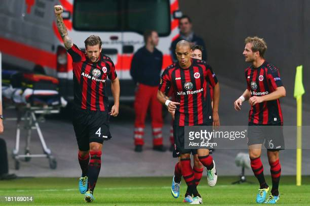 Marco Russ of Frankfurt celebrates his team's second goal with team mates Bamba Anderson and Stefan Aigner during the UEFA Europa League Group F...