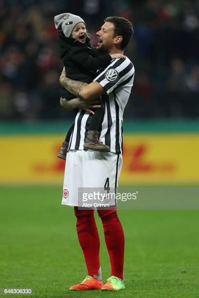 Marco Russ of Frankfurt celebrates with his daughter Vida after the DFB Cup quarter final between Eintracht Frankfurt and Arminia Bielefeld at...