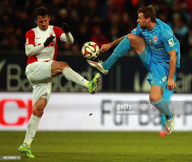 Marco Russ of Frankfurt is challenged by Markus Feulner of Augsburg during the Bundesliga match between FC Augsburg and Eintracht Frankfurt at SGL...